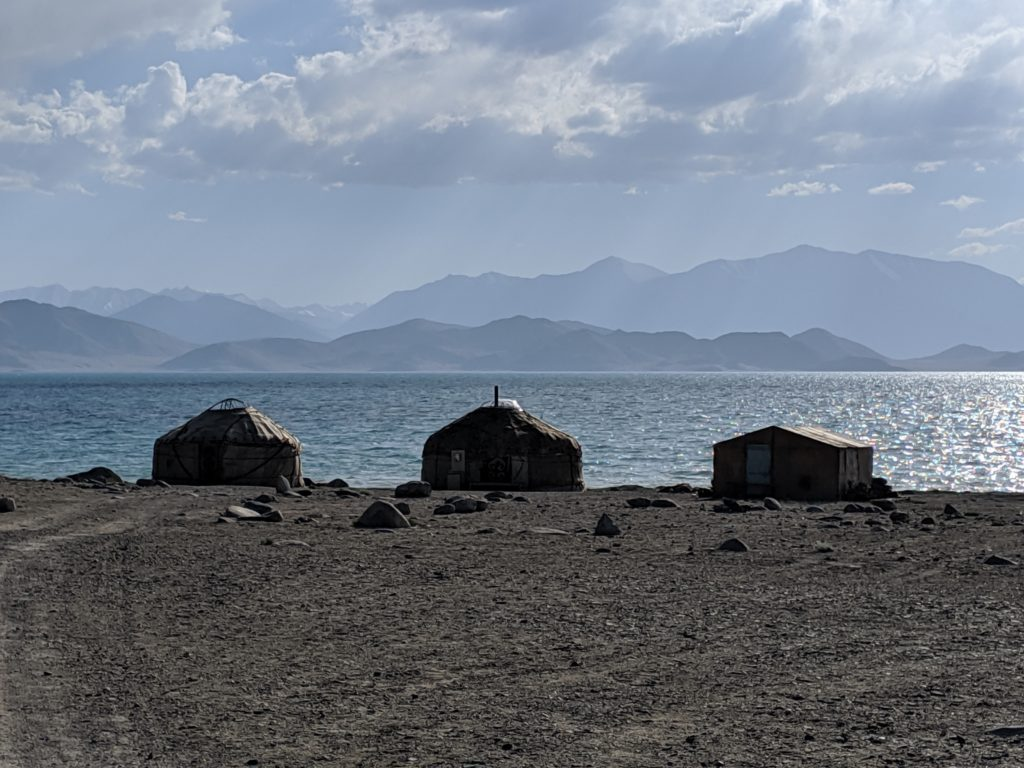 Yurts in front of a lake